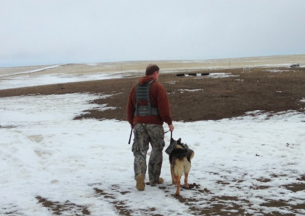 Deron with Tekoa in MOLLE Vests walking away